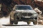 Посмотрите на новый BMW X5 в песках, снегах и на гравии